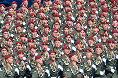 Moscow, Russia, May, 09,2015, Russian scene: The soldiers marines on parade singing the song