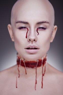 Horrible scary zombie woman. Halloween makeup.
