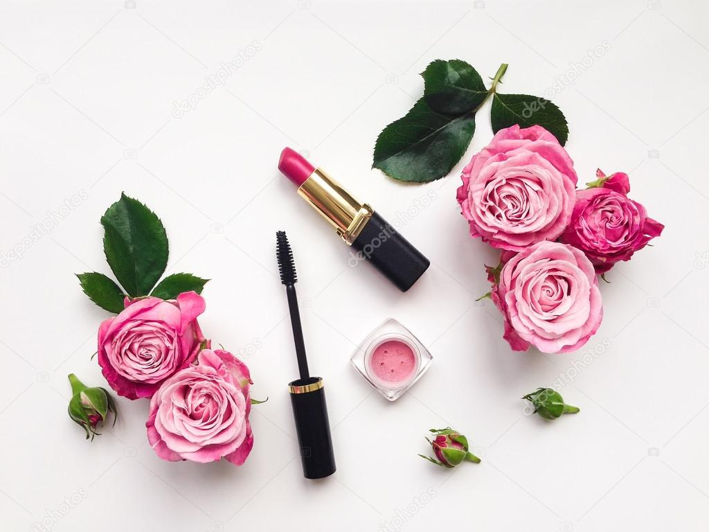 Decorative flat lay composition with cosmetics and flowers