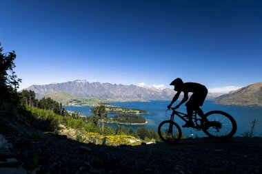Silhouette of mountain bike rider in Queenstown, New Zealand
