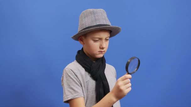 Search. A little boy search something in the air with a magnifier.