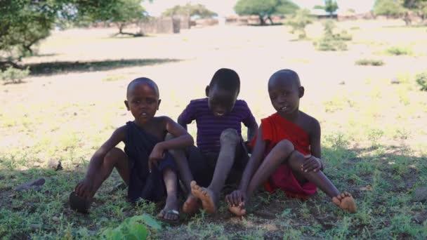 TANZANIA, ARUSHA - JAN 2020: Masai children in the African savannah in Remote village at the coast of Big Salty Natron Lake