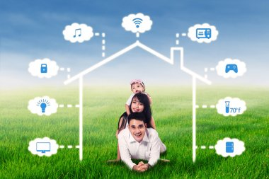 Family lying under smart house network
