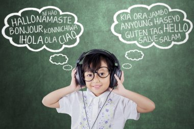 Girl learns foreign language with headphones