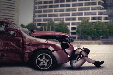Teenage girl with damaged car