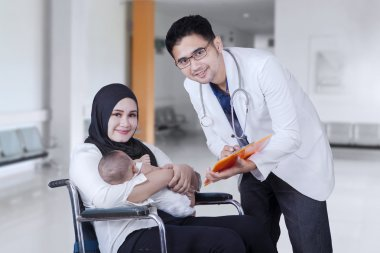 Doctor talking and disabled mother