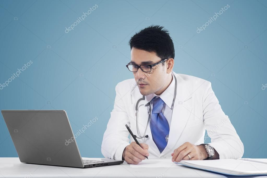 Physician makes prescription with notebook