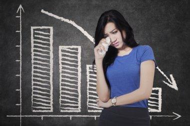 Sad woman and declining graph