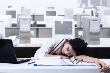 Businesswoman Sleeps In Office