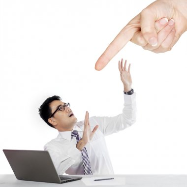 Finger pointing a businessman