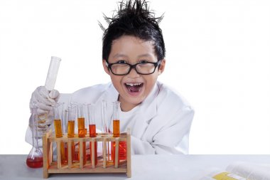 Little mad scientist doing research