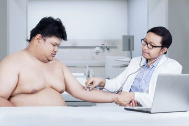 Doctor checking patient in clinic