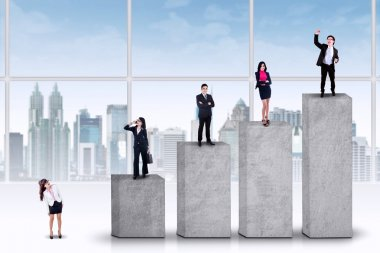 Entrepreneurs standing on the ranking bars