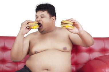 Greedy fat man eating hamburger 2