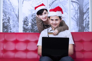 Attractive couple pay online in xmas day
