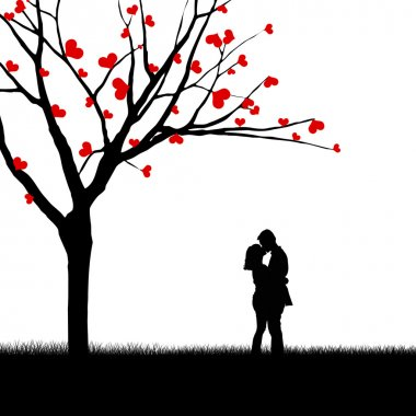 Couple kissing near love tree