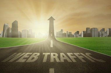 Road rises upward with web traffic text