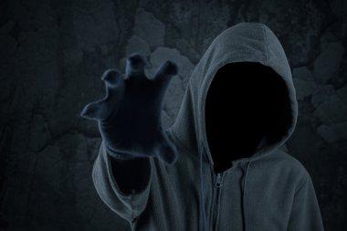 Burglar with hoody grabbing something