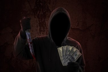 Scary robber with bloody knife and money