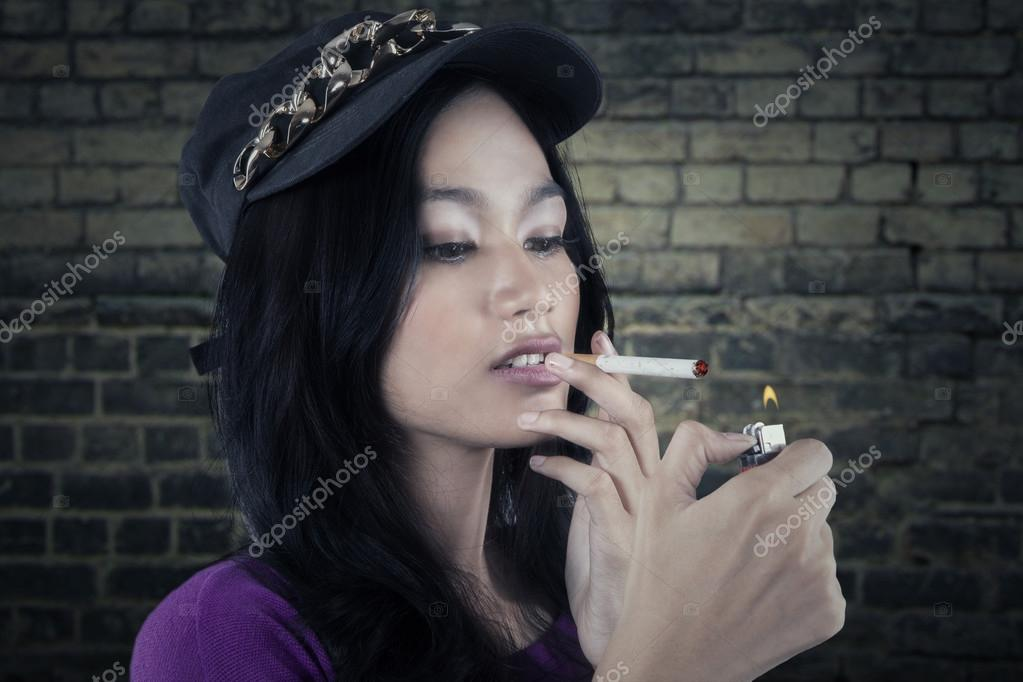 Teen girls smoking cigarettes