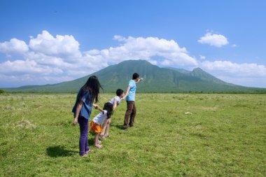 Happy family walking to the mountain