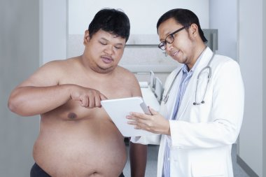 Specialist doctor with overweight patient