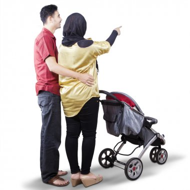Young parents with a baby stroller