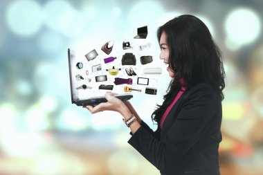 Cheerful woman with ecommerce products