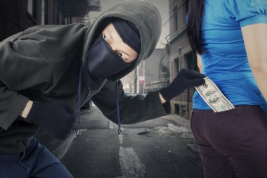 Robber stole money on the alley