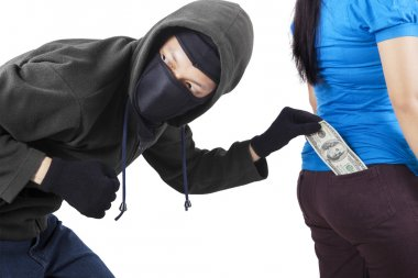 Thief in action to stole money