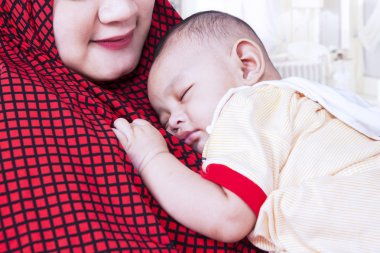 Baby boy and muslim mother