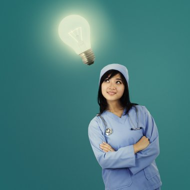 Young female surgeon with light bulb