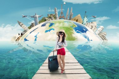 Woman ready to holiday on the world monument