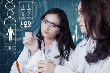 Two students doing experiments in the lab