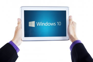 Hands holding tablet with windows 10