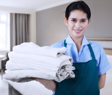 Maid is holding towels
