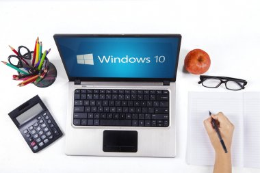 Notebook with windows 10 and student hand