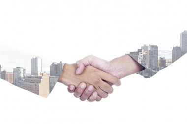 Double exposure of businesspeople shaking hands