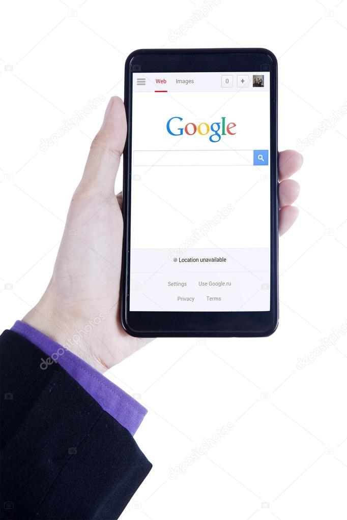 Businessman hand open google homepage on cellphone