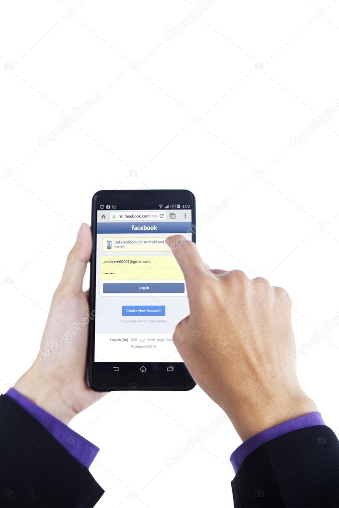 Hand touching smartphone screen with facebook site