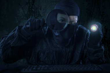Male hacker actions at night