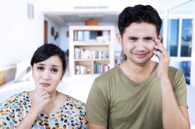 Sad couple expression at home