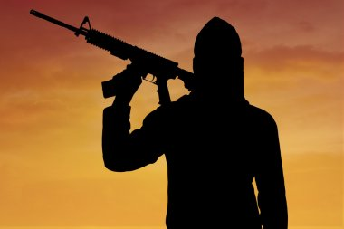 Silhouette of terrorist with rifle