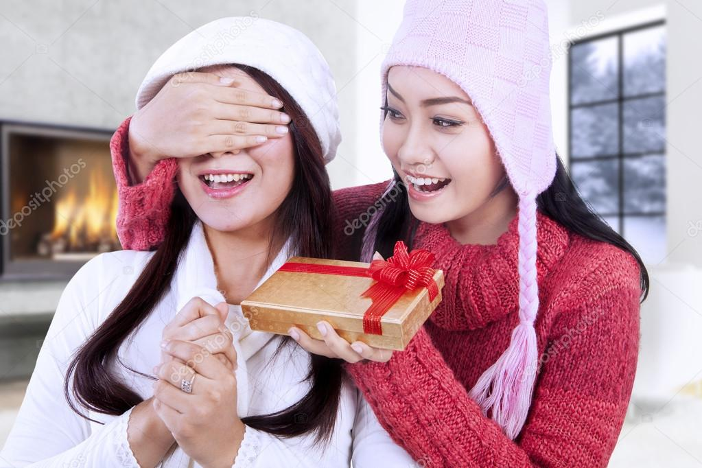 Happy woman giving christmas gift on her friend — Stock Photo ...