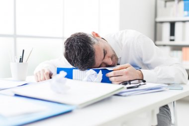 businessman sleeping on his desk