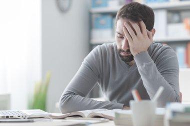 Exhausted man having a bad headache