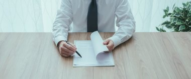 Businessman examining a business contract