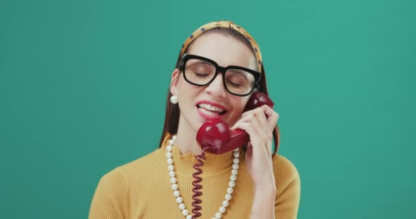 Funny woman speaking on a telephone.