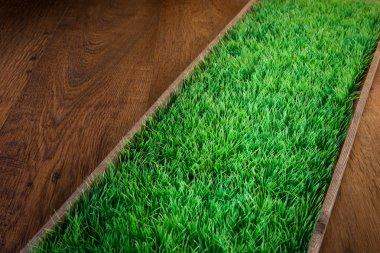 Artificial turf on hardwood floor