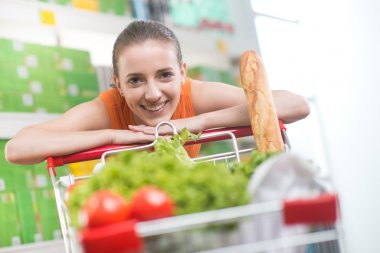 Woman leaning on shopping cart